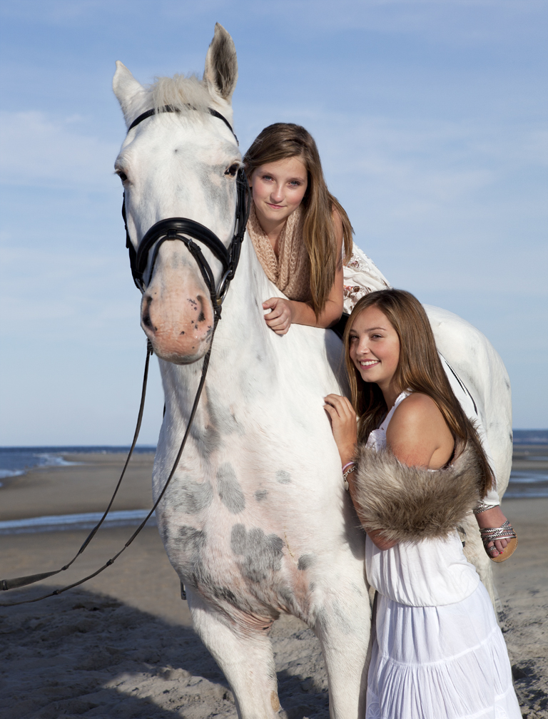 lifestyle image two young girls with horse on beach natural makeup