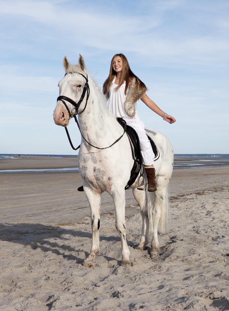 lifestyle image young girl on horseback natural makeup