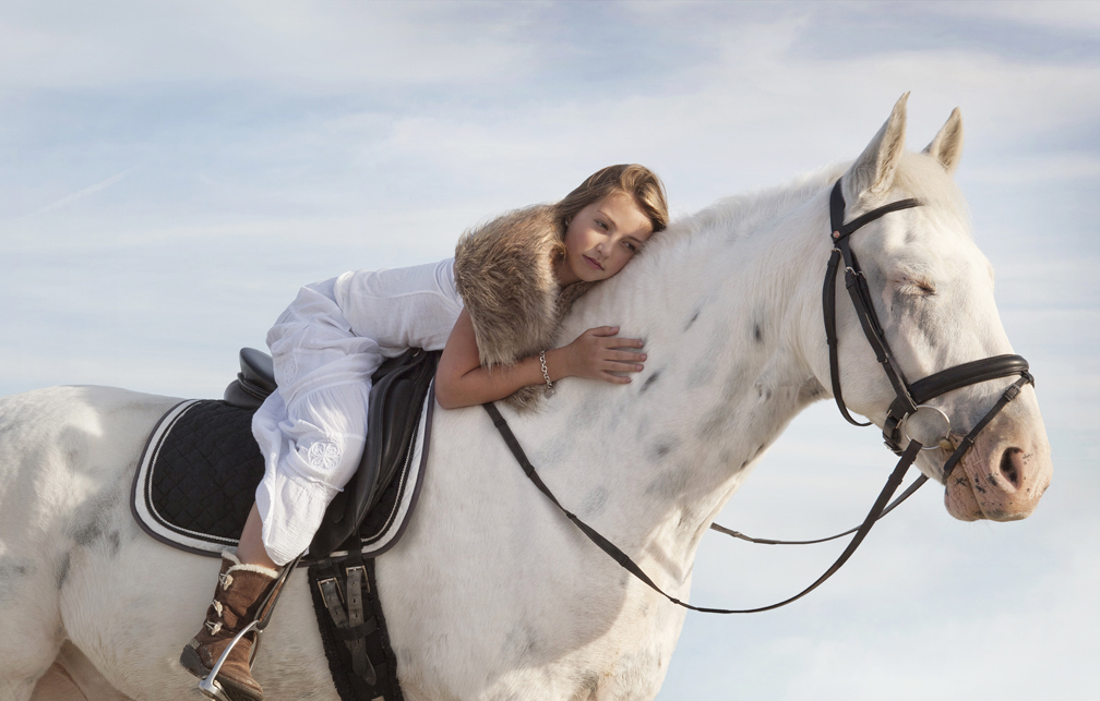 lifestyle image young girl on horseback natural makeup