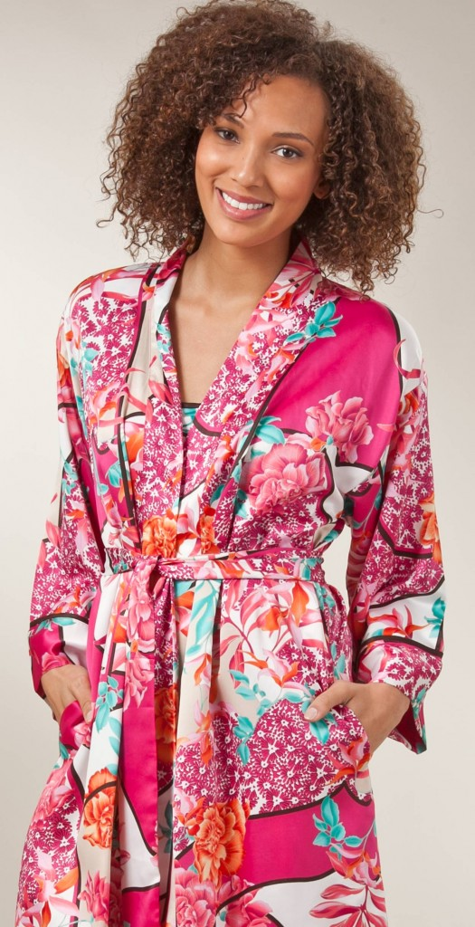 Natural makeup on smiling AfroAmerican model wearing colorful robe