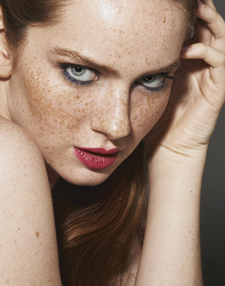 freckled redhead with pink lipstick OCC lip tar in Demure